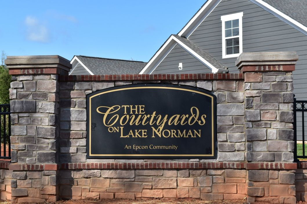 View of the entrance sign for The Courtyards On Lake Norman