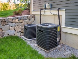 Residential heating and air conditioner compressor units near suburban house