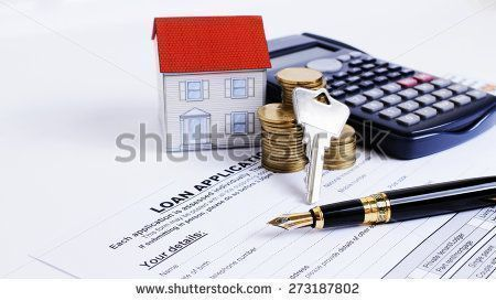 stock-photo-fountain-pen-and-key-and-calculator-and-paper-house-and-coins-stack-on-loan-application-form-for-273187802