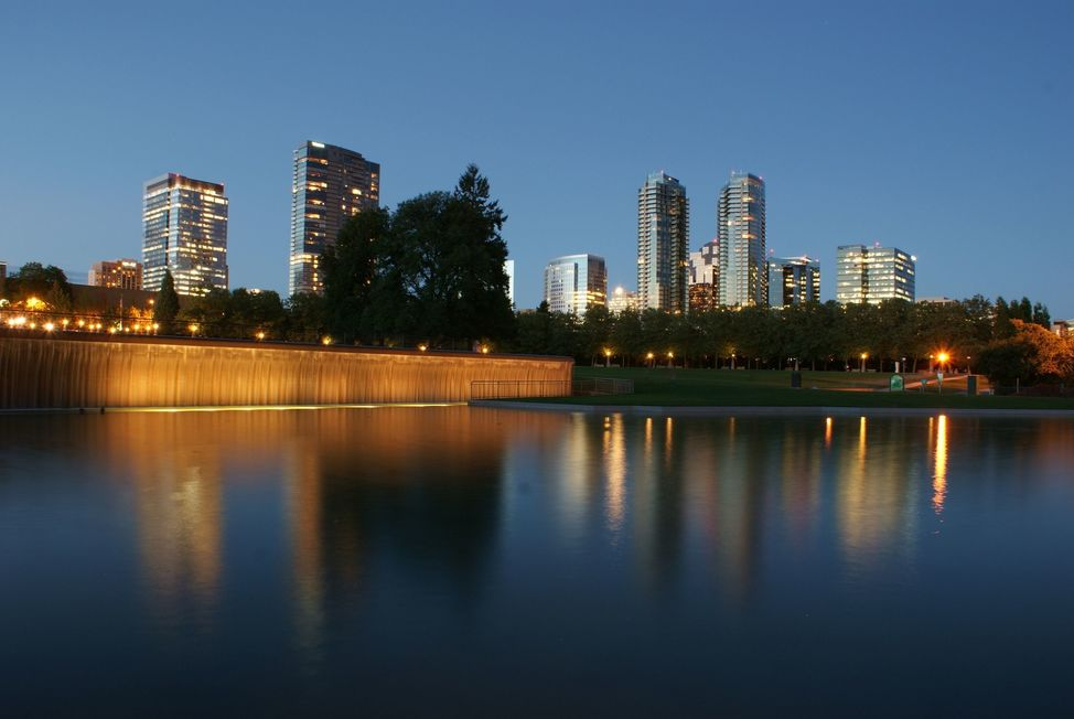 The skyline of Bellevue, Washington at twilight  reflected in a pool at Downtown Park.