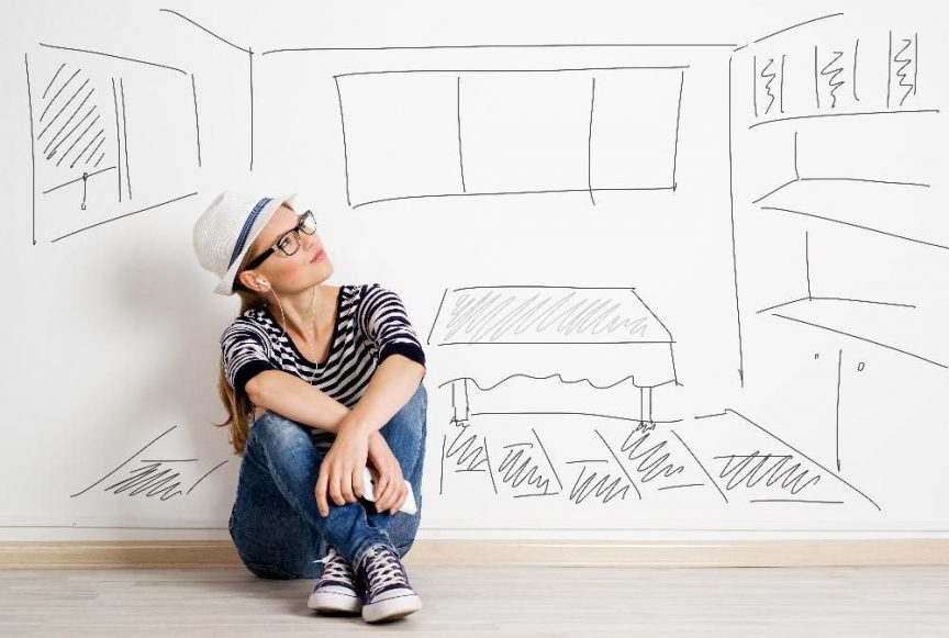 Dreaming woman in headset over drawn living room background