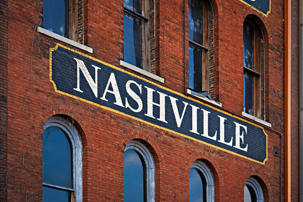 The word Nashville painted on a side of red brick building in Nashville, Tennessee.