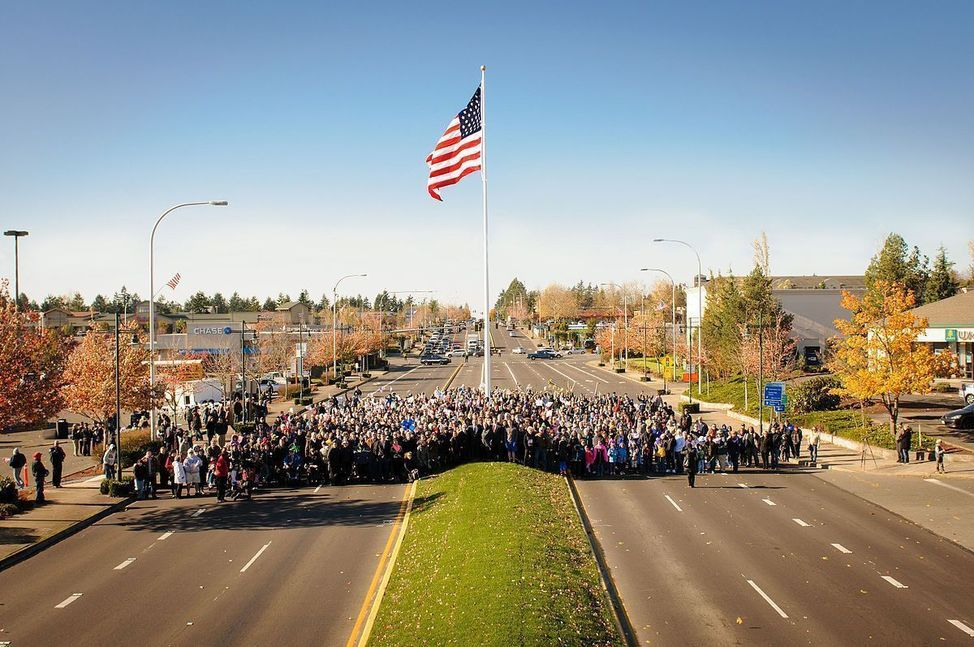 1200px-Federal_Way_Veterans_Day_Raise_The_Flag_Crowd