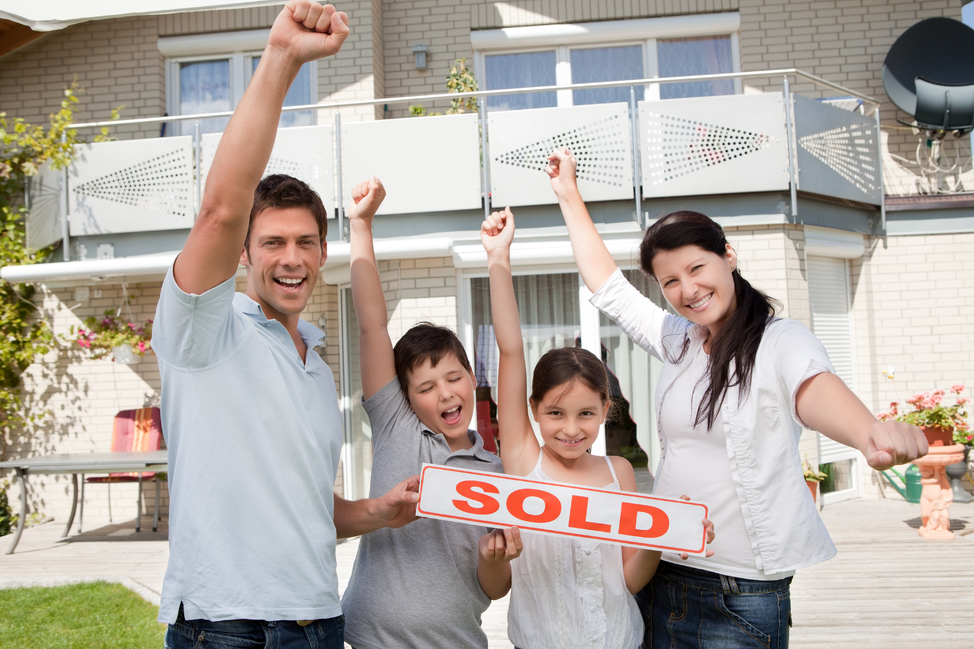 shutterstock_86988164-happy-family-sold-sign