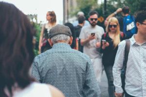 Man walking through crowd