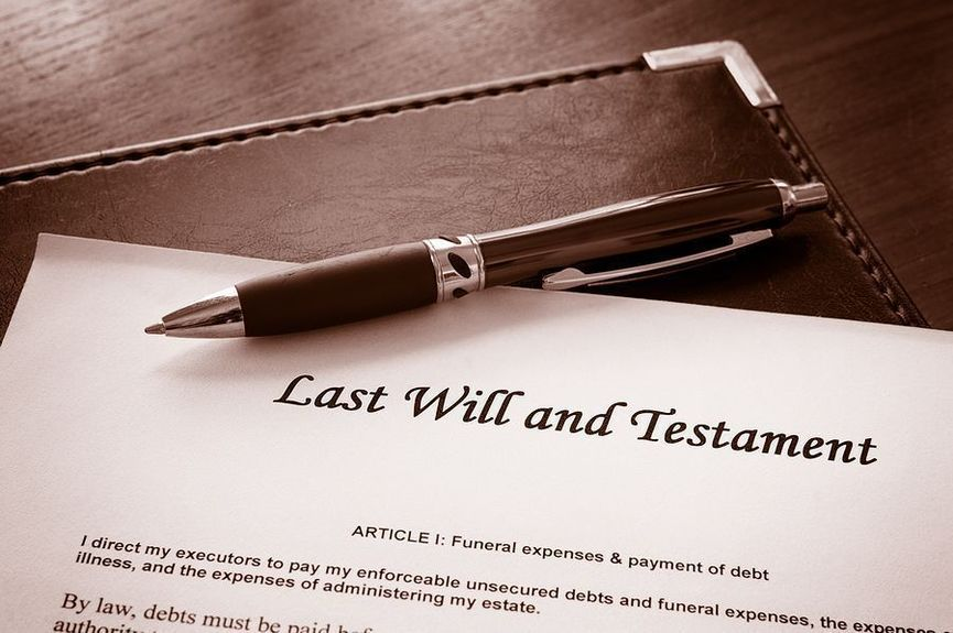A Last Will and testament document with pen