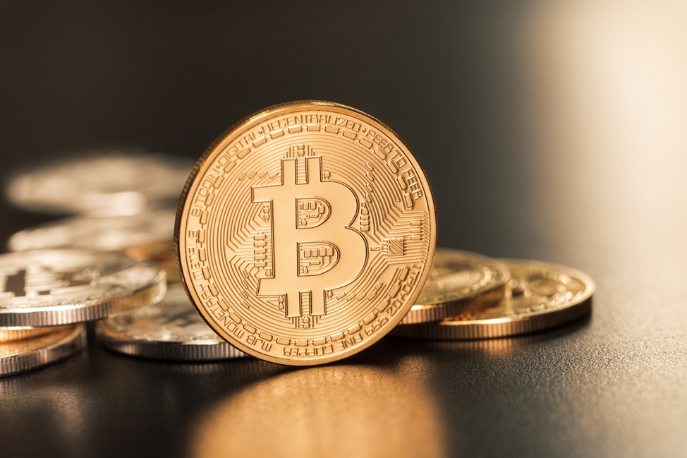 Sofia, Bulgaria - April 24, 2014: Studio shot of golden Bitcoin  virtual currency. Close-up of front side.