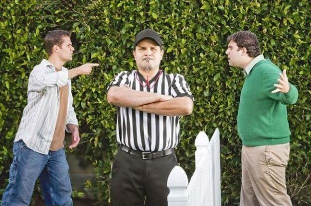 hispanic_referee_between_arguing_neighbors_bld042379-624x415