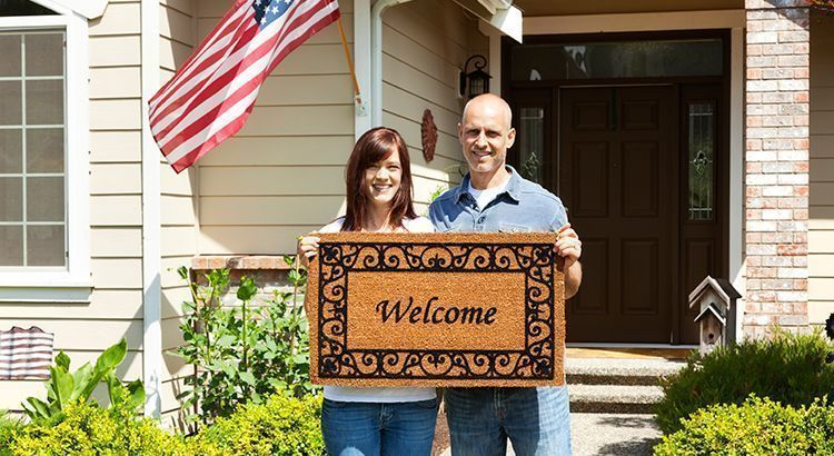 couple with welcome mat