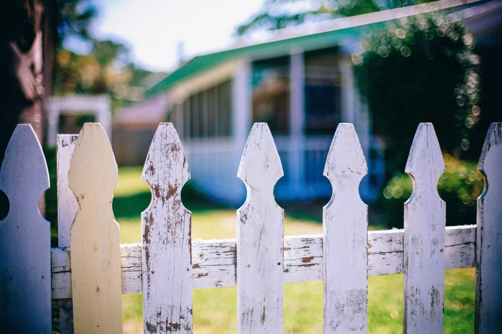 picket fence in front of house