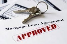 House-keys-on-top-of-approved-loan-agreement