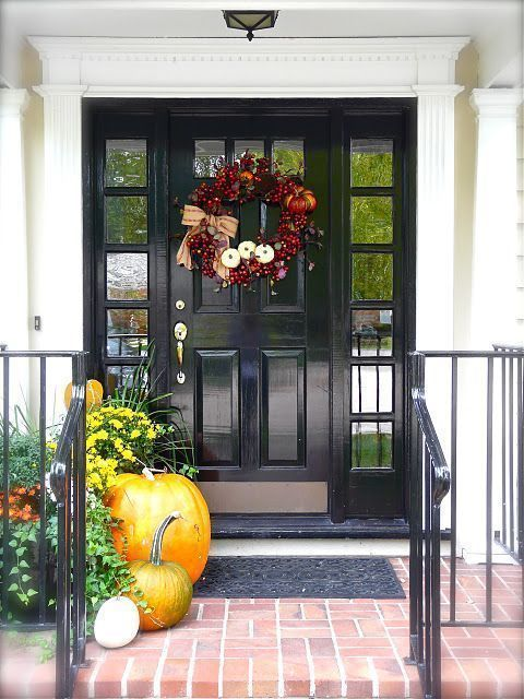 wreath and pumpkins mixed into flowers pots