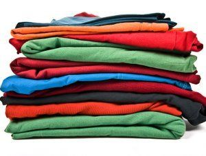Stack of color clothes isolated on white background