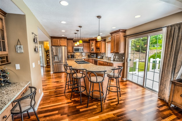 Kitchen with Hardwood Flooring and Quartz