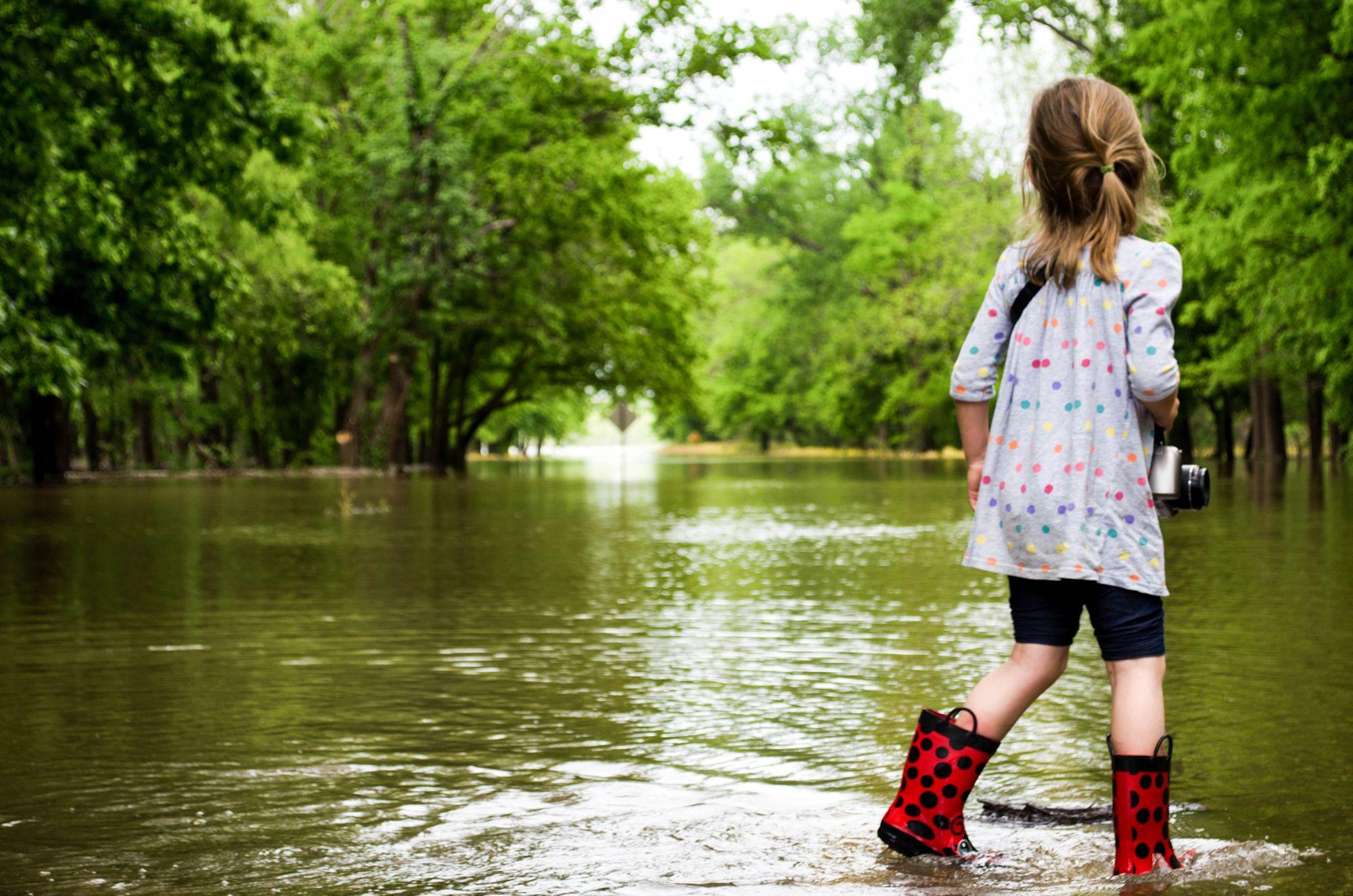 Girl Standing in Flood Waters