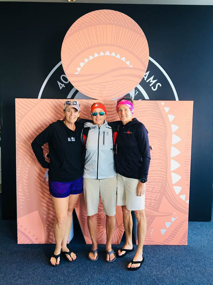 Melanie, Mary Lynne, and Ginger at Ironman 70.3 World Championship Sign