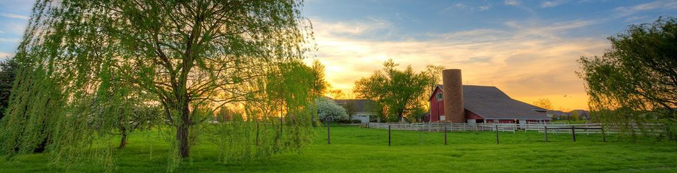 Scenic view of a typical farm in Midwest at sunset. HDR image